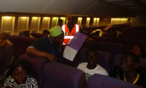 NEMA-Officials-attend-to-the-Nigeria-returnees-from-Gabon-in-the-aircraft-for-evacuation-e1350918285204.jpg