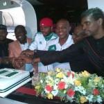 Super Eagles cutting victory cake aboard Arik Air flight