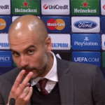 Pep Guardiola motions for the reporter to look at him