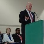 US Ambassador James Entwhistle addressing the AUN Community. Seated l-r AUN President Margee Ensign, Dr Pamela Schmoll (wife of the amb) & Dean Byron Bullock copy