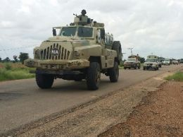 Column of patrol vehicles advancing during the    operation copy