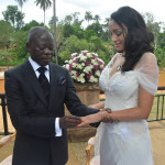 Governor Adams Oshiomhole slips puts a ring on the finger of fomer Miss Iara Fortes at a private marriage registry at Iyamho, Etsako West Local Government Area of Edo State, on Friday.
