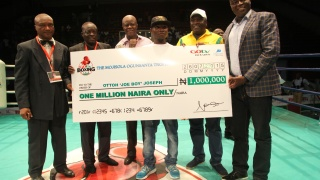 GOtv Boxing Night winner Ottoh with cheque