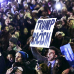 Hundreds protest in opposition of Donald Trump's presidential election victory on Boston Common in Boston, Wednesday evening, Nov. 9, 2016. (AP Photo/Charles Krupa)