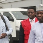 MUHAMMED DELE BELGORE AND PROF. ABUBAKAR SULAIMAN ON THEIR WAY TO THE COURTROOM.