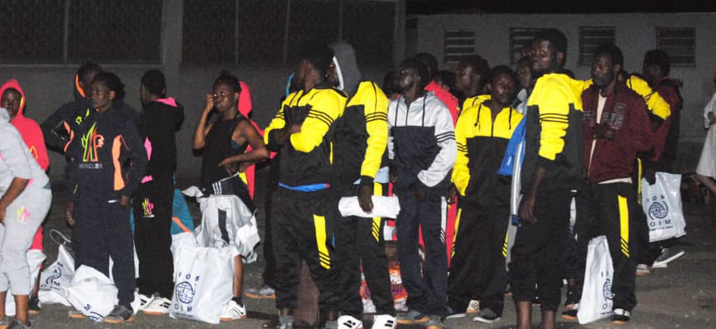 PIC.29.-NIGERIAN-DEPORTEES-FROM-LIBYA-ARRIVE-MMA-IN-IKEJA-e1493179281346-1024x471.jpg