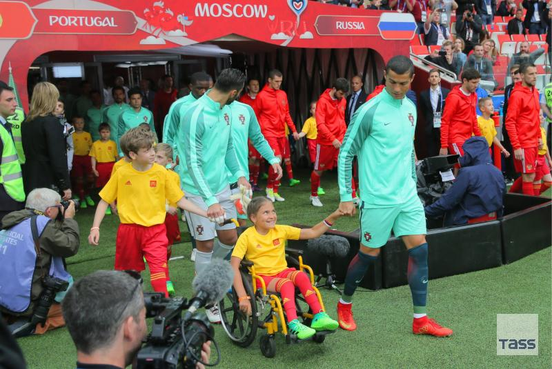 Ronaldo-walks-a-disabled-girl-onto-the-field-to-face-Russia.jpg