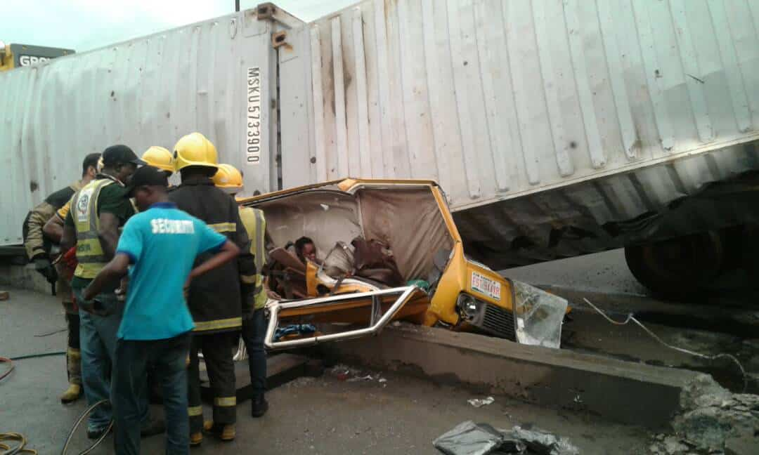 TRAGIC: Container Falls Loaded Commercial Buses In Ojota